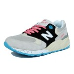 Tênis New Balance NB 999 Feminino Cor Cinza Claro com Detalhes Preto Azul e Cardaço Laranja